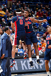 ST. LOUIS, Mo., -- Game 02 of the 2018 SEC Men's Basketball Tournament played between Ole Miss and South Carolina, Wednesday, March 07, 2018 at the Scott Trade Center in ST. LOUIS. Ole Miss guard Devontae Shuler, left celebrates with guard Deandre Burnett in the second half.