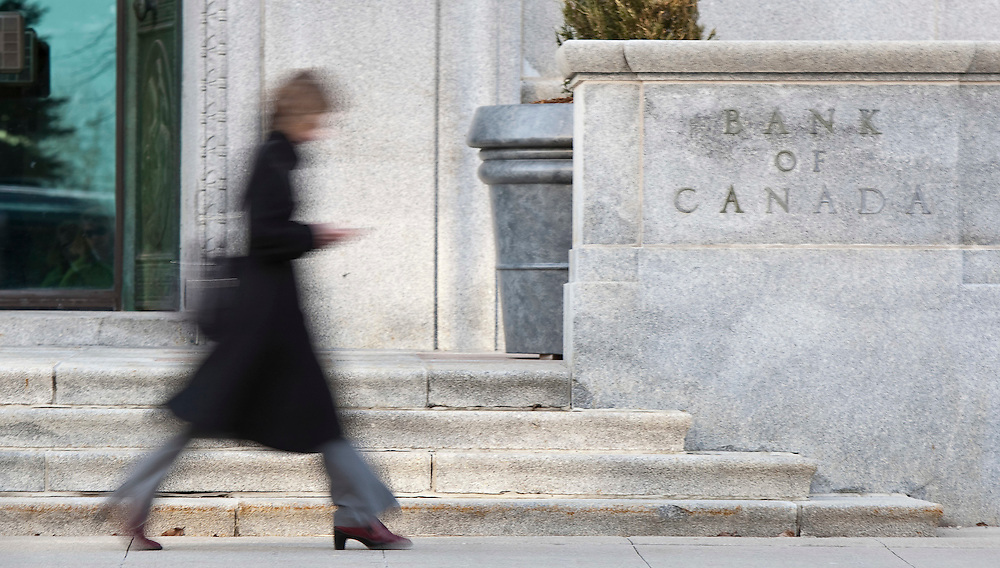 A woman walks by the Bank of Canada building on Wellington Street in Ottawa Tuesday April 12, 2011. The central bank will announce it's interest rate decision this morning.<br /> AFP/GEOFF ROBINS/STR