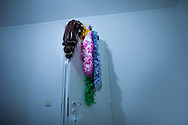 The wig and Alan´s garments hanging on the door of his room.