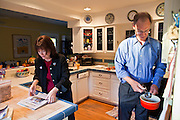 26 OCTOBER 2010 - PHOENIX, AZ: Terry Goddard (RIGHT) gets water for breakfast while his wife, Monica, sets out the morning papers in their home in central Phoenix. Goddard lost the election to sitting Governor Jan Brewer, a conservative Republican.     PHOTO BY JACK KURTZ