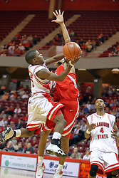 "11 November 2007: Keith ""Boo"" Richardson goes hard to the bucket against Jason Black. Illinois State Redbirds defeated the Missouri - St. Louis Tritons 70-37 in an early season game on Doug Collins Court in Redbird Arena on the campus of Illinois State University in Normal Illinois."