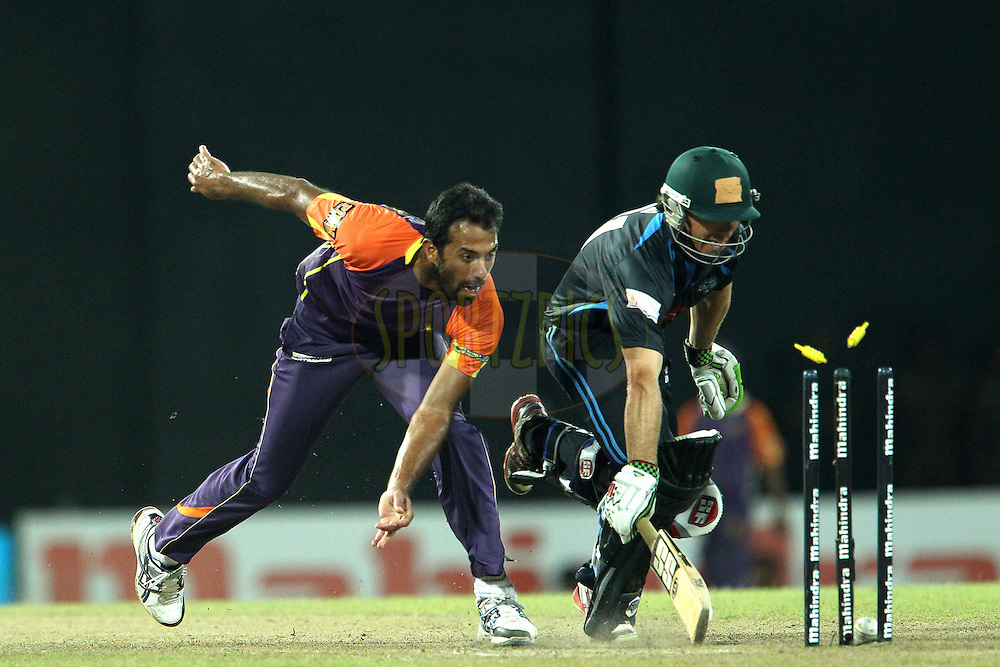 Wahab Riaz tries to run out Brad Hogg but he is safe during match 20 of the Sri Lankan Premier League between Ruhuna Royals and Wayamba United held at the Premadasa Stadium in Colombo, Sri Lanka on the 26th August 2012. .Photo by Ron Gaunt/SPORTZPICS/SLPL