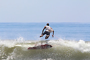Surfing the waved of the Pacific ocen. Photographed in El Tunco, El Salvador