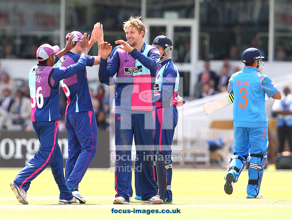 Ollie Rayner ( R ) of Middlesex County Cricket Club celebrates with team mates after taking the wicket of Suresh Raina ( R ) of India during the Tour Match at Lord's, London<br /> Picture by Paul Terry/Focus Images Ltd +44 7545 642257<br /> 22/08/2014