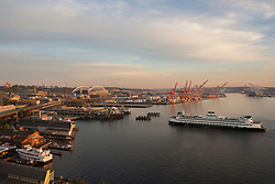 United States, Washington, Seattle, Elliott Bay waterfront, ferry and Port of Seattle with cranes