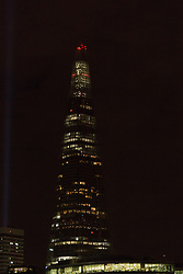© Licensed to London News Pictures. 05/07/2014. London, UK. The Shard in London is seen with the spire lights switched off. Landmarks across London and the UK are turning their lights off from 10pm to 11pm tonight to mark the First World War centenary. Photo credit : Vickie Flores/LNP