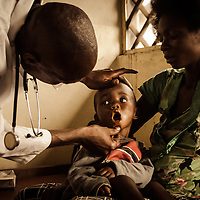 A Doctor does his rounds in a rural clinic in Dibindi, DRC.