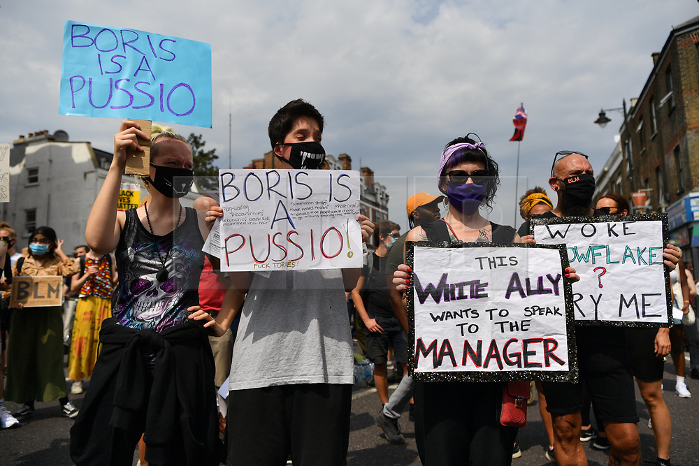 © Licensed to London News Pictures. 08/08/2020. London, UK. Black Lives protesters demonstrate outside Tottenham police station organised by organisation Black Lives Matter. The demonstration marks the 9th anniversary of the 2011 London Riots. Photo credit: London News Pictures