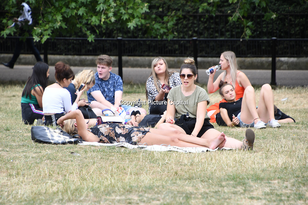 People picnic at Green Park as Heatwaves continues in the UK on July 22 2018,  London, UK