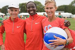 legendary elite runners Joan Benoit Samuelson, Catherine Ndereba, Colleen DeReuck after race