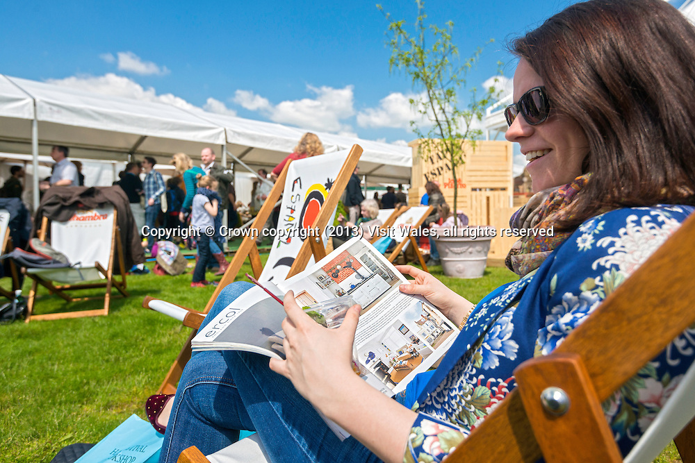 Woman sitting in deckchair reading book<br /> Hay Literary Festival 2013<br /> Hay-on-Wye<br /> Powys<br /> South<br /> Culture<br /> Arts<br /> Events