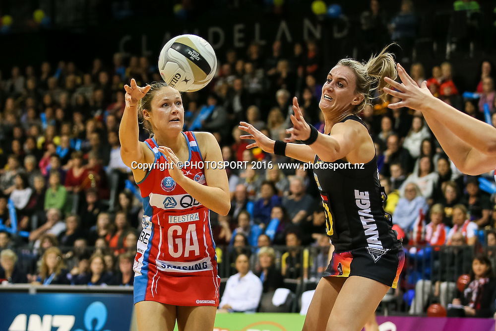 NSW Swift's Susan Pettitt fires a pass past Waikato BOP's Leana De Bruin during the ANZ Netball Championship semi final between the Waikato BOP Magic and the NSW Swifts, played at Claudelands Arena, Hamilton, New Zealand on Monday 25 July 2016.  Copyright Photo: Bruce Lim / www.photosport.nz