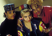 Salt n' Pepa wearing prominent red lipstick and colourful attire, Hip Hop artists, New York, U.S.A, 1980s.