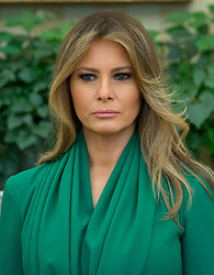 First lady Melania Trump stands as United States President Donald J. Trump meets King Abdullah II of Jordan in the Oval Office of the White House in Washington, DC on Wednesday, April 5, 2017.<br /> Credit: Ron Sachs / Pool via CNP *** Please Use Credit from Credit Field ***
