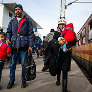 Hamood, 6, from Hama, Syria, holds his dad's hand after arriving at the Tabanovce, Macedonia train station, their stop before they cross the border into Serbia, on their way into Western Europe. January 2016.