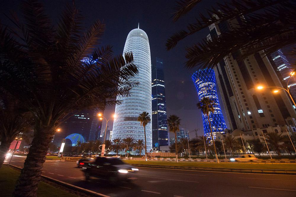 """08 APR 2013, DOHA/QATAR<br /> Doha Tower (links, weiss), auch """"Condom Tower"""", Tornado Tower (mitte blau) und All Jassimya Tower (rechts), gesehen von der Al Corniche Street<br /> IMAGE: 20130408-01-039<br /> KEYWORDS: Katar, Hochaus, Wolkenkratzer, Tower, Skyscraper, Skyline, Nacht, night, Nacht, night, Nachtaufnahme, Hochhaeuser, Hochäuser, Skyscraper, West Bay, Dwontown Doha"""