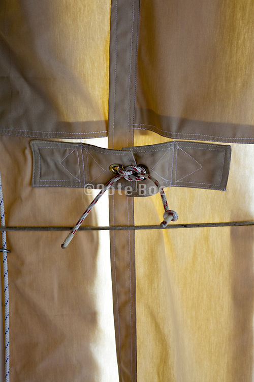 heavy duty canvas type curtain closed with a rope