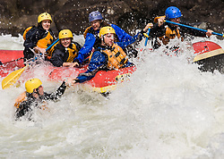 Unidentified whitewater rafters rescue an unidentified rafter who fell out of a raft in the rapids at Pillow Rock on the Gauley River during American Whitewater's Gauley Fest weekend. The upper Gauley, located in the Gauley River National Recreation Area is considered one of premier whitewater rivers in the country.