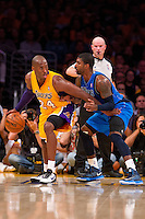 30 October 2012: Guard (24) Kobe Bryant of the Los Angeles Lakers dribbles while being defended by (32) O.J. Mayo of the Dallas Mavericks during the second half of the Mavericks 99-91 victory over the Lakers at the STAPLES Center in Los Angeles, CA.