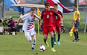 Portugal midfielder Diogo Prioste (8) dribbles the ball away from Team USA midfielder Evan Rotundo (10) during a CONCACAF boys under-15 championship soccer game, Saturday, August 10, 2019, in Bradenton, Fla. Portugal defeated Team USA 3-0 and advanced to the finals against Slovenia. (Kim Hukari/Image of Sport)