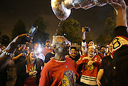 Blackhawks fans celebrate the team's Stanley Cup victory outside the United Center.