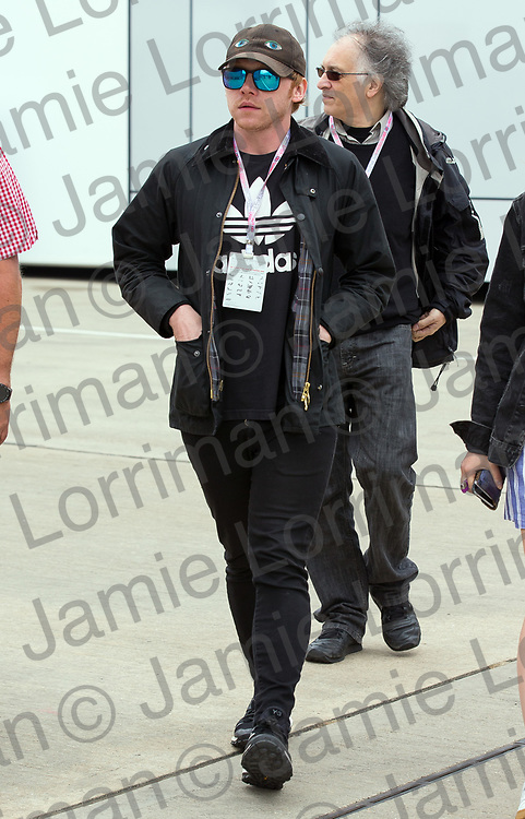 The 2017 Formula 1 Rolex British Grand Prix at Silverstone Circuit, Northamptonshire.<br /> <br /> Pictured: Actor Rupert Grint walks through the F1 paddock at Silverstone Circuit on qualifying day.<br /> <br /> Jamie Lorriman<br /> mail@jamielorriman.co.uk<br /> www.jamielorriman.co.uk<br /> +44 7718 900288