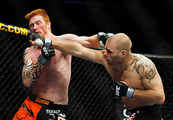 November 17, 2007; Newark, NJ, USA;  Joe Doerkson (black/white trunks) and Ed Herman (orange/black trunks) battle during their bout at UFC 78: Validation at the Prudential Center in Newark, NJ.  Herman won via one punch left hook KO in the 3rd round.