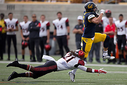 BERKELEY, CA - SEPTEMBER 12:  Running back Daniel Lasco #2 of the California Golden Bears jumps past defensive back Na'im McGee #21 of the San Diego State Aztecs during the first quarter at California Memorial Stadium on September 12, 2015 in Berkeley, California. The California Golden Bears defeated the San Diego State Aztecs 35-7. (Photo by Jason O. Watson/Getty Images) *** Local Caption *** Daniel Lasco; Na'im McGee