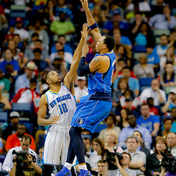 Apr 14, 2013; New Orleans, LA, USA; Dallas Mavericks shooting guard O.J. Mayo (32) shoots over New Orleans Hornets shooting guard Eric Gordon (10) during the first half of a game at the New Orleans Arena. Mandatory Credit: Derick E. Hingle-USA TODAY Sports