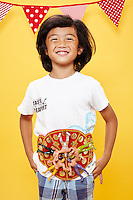 Boy standing proud wearing a mexican wrestling belt against yellow seamless<br /> Photographed at the Photoville Photo Booth September 20, 2015