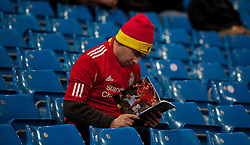11.01.2012, Etihad Stadion, Manchester, ENG, Carling Cup, Manchester City vs FC Liverpool, Halbfinale, im Bild A Liverpool reading the match programme before the football match of English Carling Cup, Halffinal, between Manchester City and FC Liverpool at Etihad Stadium, Manchester, United Kingdom on 2012/01/11. EXPA Pictures © 2012, PhotoCredit: EXPA/ Propagandaphoto/ David Rawcliff..***** ATTENTION - OUT OF ENG, GBR, UK *****