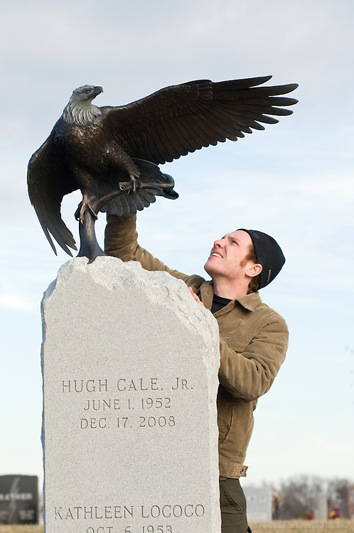 Eagle sculpture atop the memorial stone for Hugh Cale Wright (June 01, 1952 - December 17, 2008) and his wife Kathleen Lococo Wright in Calvary Cemetery by Matt Weir, photographed Thursday, Jan. 14, 2010 in Louisville, Ky. (Photo by Brian Bohannon)