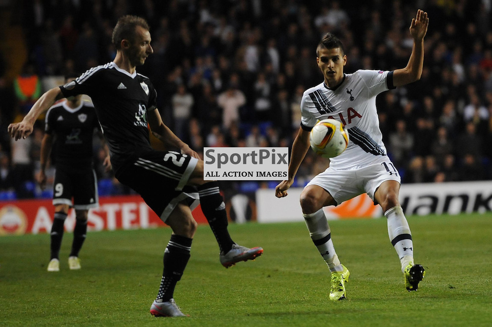 Tottenhams Erik Lamela and Qarabags Amso Agolli in action during the Tottenham v Qarabag match in the Europa League group stage
