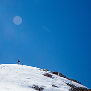 Griffin Post hikes up a cornice line in Glacier National Park.