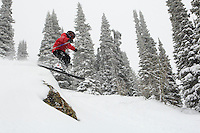An 8 year old boy catches a little air on a powder day somewhere in Jackson Hole, WY.