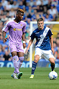 Aaron Tshibola and Stephen Gleeson during the Sky Bet Championship match between Birmingham City and Reading at St Andrews, Birmingham, England on 8 August 2015. Photo by Alan Franklin.