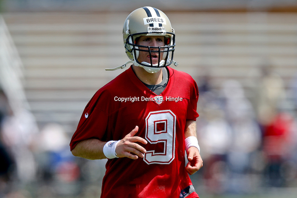 Jul 26, 2013; Metairie, LA, USA; New Orleans Saints quarterback Drew Brees (9) during the first day of training camp at the team facility. Mandatory Credit: Derick E. Hingle-USA TODAY Sports
