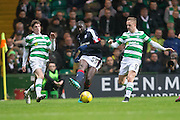 Dundee's Kevin Gomis clears as Celtic's Ryan Christie and Leigh Griffiths try to close him down - Celtic v Dundee in the Ladbrokes Scottish Premiership at Celtic Park, Glasgow. Photo: David Young<br /> <br />  - © David Young - www.davidyoungphoto.co.uk - email: davidyoungphoto@gmail.com