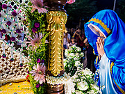 30 MARCH 2018 - BANGKOK, THAILAND: A woman representing Mary, the Mother of Jesus, prays after viewing Jesus' body during Good Friday observances at Santa Cruz Church in the Thonburi section of Bangkok. Santa Cruz Church is more than 350 years old and is one of the oldest Catholic churches in Thailand. Good Friday is the day that most Christians observe as the crucifixion of Jesus Christ. Thailand has a small Catholic community.       PHOTO BY JACK KURTZ