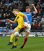 Sean Raggett (20) of Portsmouth battles for possession with Alex Samuel (25) of Wycombe Wanderers during the EFL Sky Bet League 1 match between Portsmouth and Wycombe Wanderers at Fratton Park, Portsmouth, England on 26 December 2019.