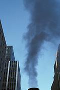 smoke stack and surrounding buildings