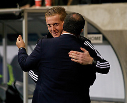 SWANSEA, WALES - Thursday, February 20, 2014: Swansea City's manager Gary Monk and SSC Napoli's head coach Rafael Benitez before the UEFA Europa League Round of 32 1st Leg match at the Liberty Stadium. (Pic by David Rawcliffe/Propaganda)