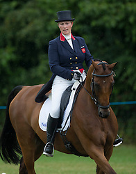 Image ©Licensed to i-Images Picture Agency. 02/08/2014. , United Kingdom. Zara Phillips rides High Kingdom at theFestival of British Eventing. Gatcombe. Picture by i-Images