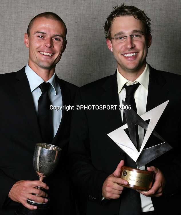 Chris Martin, Winsor Cup winner for the most meritorious bowling performances in men's first-class cricket and Daniel Vettori, National Bank Cup player of the Year, show off their trophies at the New Zealand Cricket Awards held at Langham Hotel, Auckland, on Thursday 30 March, 2006. Photo: Andrew Cornaga/PHOTOSPORT