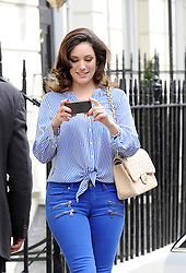 Kelly Brook leaving her home wearing tight skinny blue jeans and a blue shirt with high red heel shoes. London UK. 17/04/2013<br />BYLINE MUST READ : GOTCHAIMAGES.COM<br /><br />Copyright by © Gotcha Images Ltd. All rights reserved.<br />Usage of this image is conditional upon the acceptance <br />of Gotcha Images Ltd, terms and conditions available at<br />www.gotchaimages.com