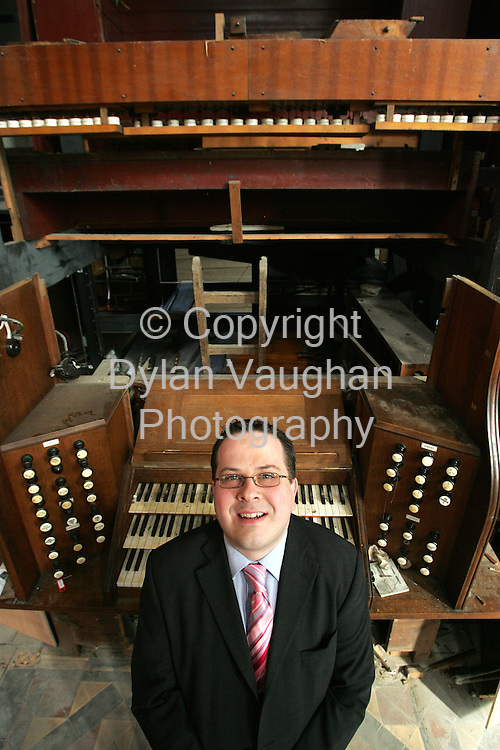 22/4/2006.Mark Bowyer pictured with the organ at St Canices Cathedral which is undergoing restoration..Picture Dylan Vaughan.