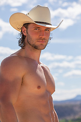 muscular shirtless cowboy outdoors