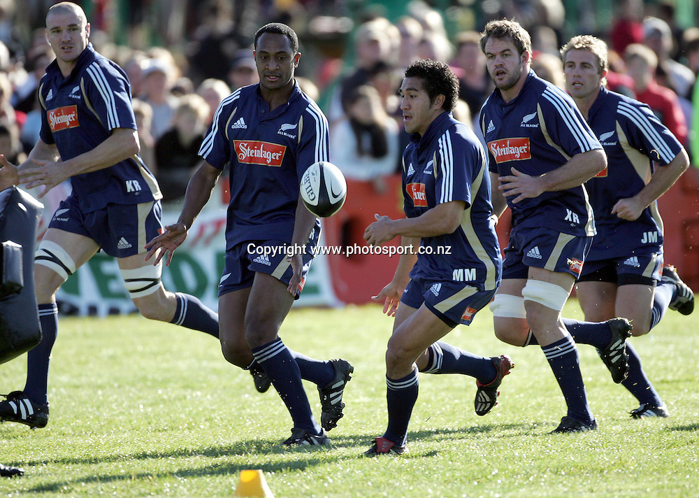 Malili Muliaina passes to Joe Rokocoko during the All Blacks training session at Silverdale United RFC, North of Auckland, New Zealand, Wednesday 7th July 2004. The All Blacks play the Pacific Islanders on Saturday.<br />