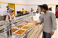 """ROME, ITALY - SEPTEMBER 24: A guest during  the dinner the refectory at the hostel  """"Don Luigi Di Liegro"""" of the Caritas of Rome in Via Marsala, Rome. The new facility of 500 for the evening canteen and 300 beds to the hostel,  hosts marginalized people. The hostel opened in 1987 has been renovated to make it more efficient, the social reintegration of the guests  on September 24, 2016 in Rome, Italy."""