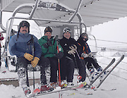 (from left to right) Boyne Highlands Resort  general manager Brad Keen, Boyne Snow Sports Academy director Tony Sendlhoffer, Boyne Resorts vice president of Ski Operations John McGregor and his wife Marcie take the first chair lift ride to the top of the resorts Heather run to officially start the resorts 2009/10 ski season.